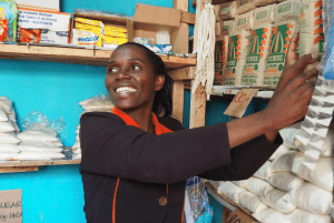 Micro-retail in Africa - woman shop keeper organizing store inventory